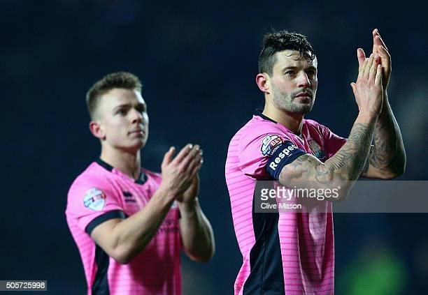 Marc Richards of Northampton Town applauds the fans at the end of the Emirates FA Cup third round replay match between Milton Keynes Dons and...
