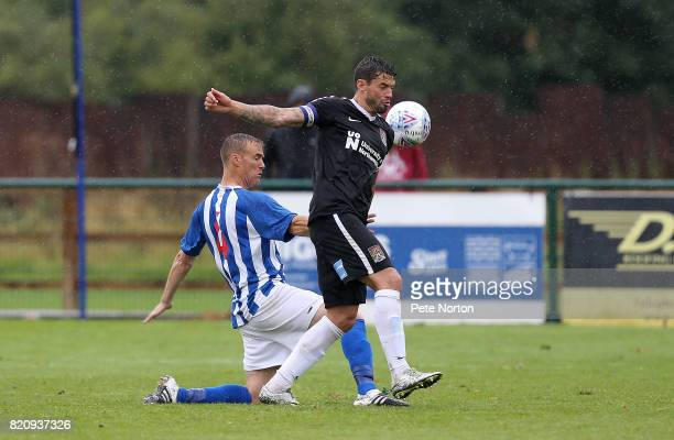 Marc Richards of Northampton Town attempts to control the ball under pressure from Brett Solkhon of Kettering Town during the PreSeason Friendly...