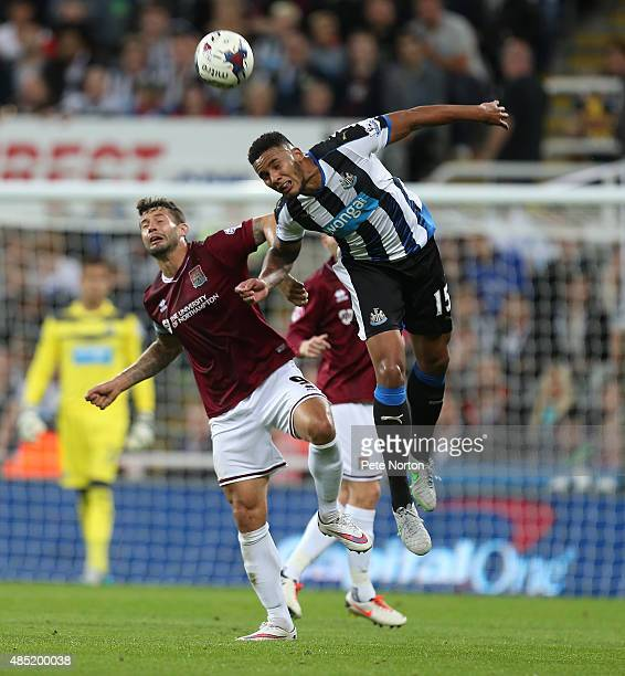 Marc Richards of Northampton Town challenges for the ball with Jamaal Lascelles of Newcastle United during the Capital One Cup Second Round match...