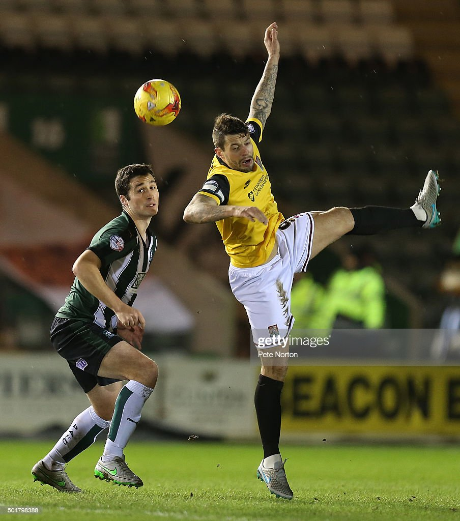 Marc Richards of Northampton Town contests the ball Carl McHugh of Plymouth Argyle during the Sky Bet League Two match between Plymouth Argyle and Northampton Town at Home Park on January 12, 2016 in Plymouth, England.