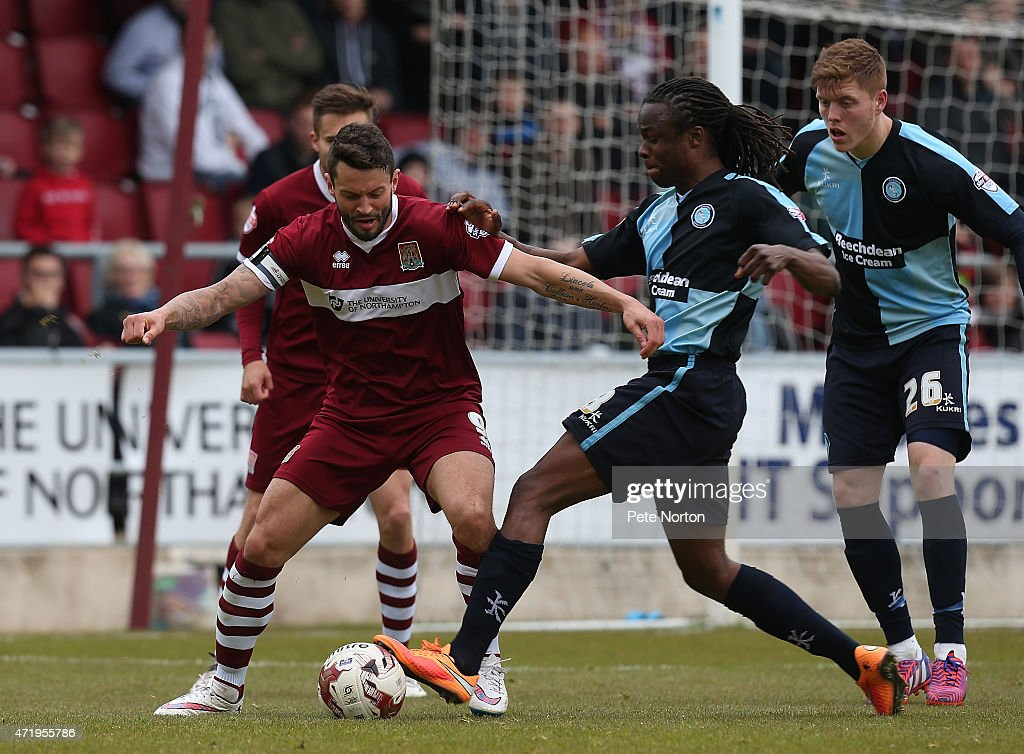 Marc Richards of Northampton Town contests the ball with Marcus Bean of Wycombe Wanderers during the Sky Bet League Two match between Northampton Town and Wycombe Wanderers at Sixfields Stadium on May 2, 2015 in Northampton, England.