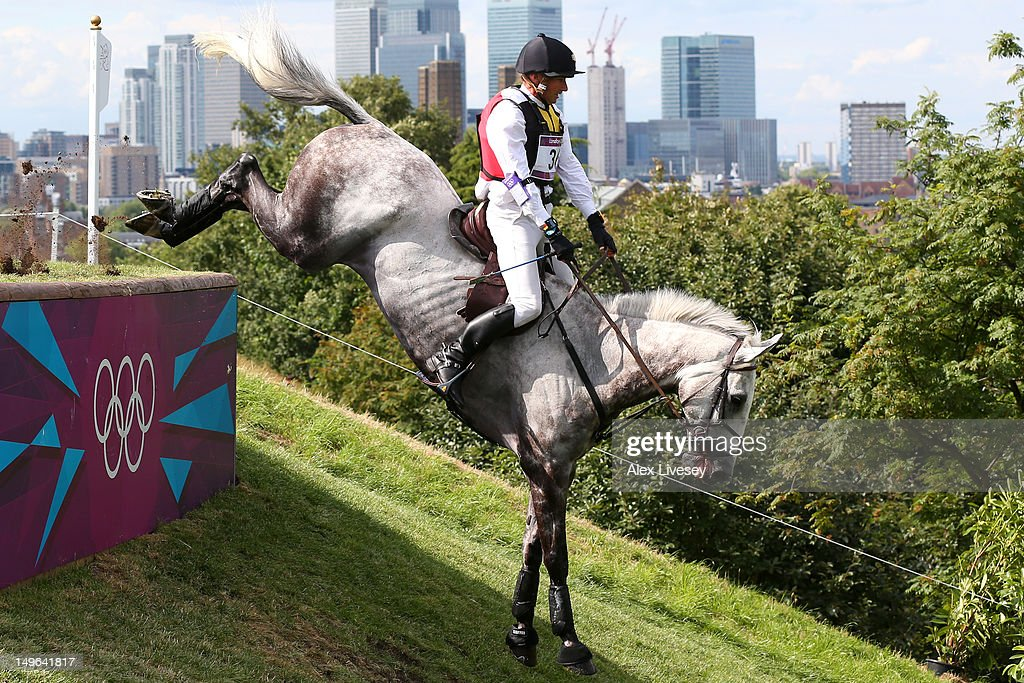 Marc Rigouts of Belgium riding Dunkas negotiates a jump in the Eventing Cross Country Equestrian event on Day 3 of the London 2012 Olympic Games at...