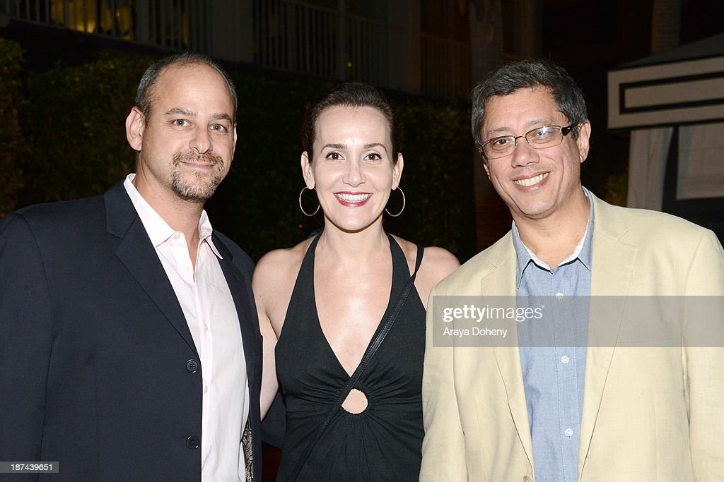 Marc Roskin, Rachel Olschan and <a gi-track='captionPersonalityLinkClicked' href=/galleries/search?phrase=Dean+Devlin&family=editorial&specificpeople=540462 ng-click='$event.stopPropagation()'>Dean Devlin</a> attend the Electric Entertainment AFM Party at the Viceroy Hotel on November 8, 2013 in Santa Monica, California.