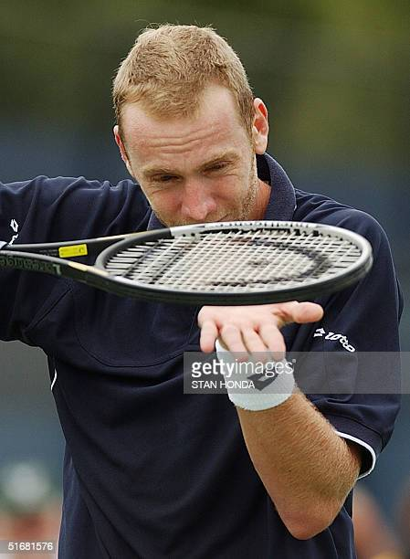 Marc Rosset of Switzerland tries to divine the reason for a missed shot with his racquet during his match against Sebastien Grosjean of France at the...