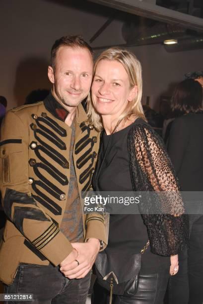 Marc Ryan and Magic Garden PR Beatrix Mourer attend 'Anachronisme' Nikon 100th Anniversary Party At Le Dernier Etage on September 21 2017 in Paris...