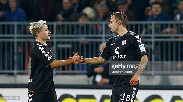 Marc Rzatkowski and Goalgetter Lennart Thy of St Pauli celebration after the Goal 20 for St Pauli during the Second Bundesliga match between FC St...