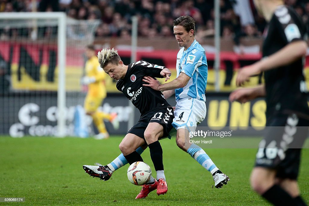 Marc Rzatkowski (L) of Hamburg and Kai Buelow (R) of Muenchen compete for the ball during the Second Bundesliga match between FC St. Pauli and 1860 Muenchen at Millerntor Stadium on April 29, 2016 in Hamburg, Germany.
