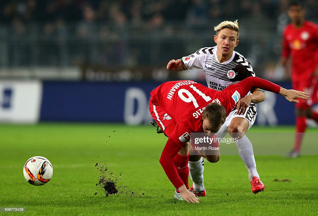 Marc Rzatkowski (R) of St. Pauli challenges for the ball with Lukas Klosterman of Leipzig during the second Bundesliga match between FC St. Pauli and RB Leipzig at Millerntor Stadium on February 12, 2016 in Hamburg, Germany.