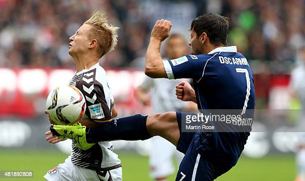 Marc Rzatkowski of St Pauli challenges for the ball with Michael Goerlitz of Bielefeld during the second Bundesliga match between FC St Pauli and...