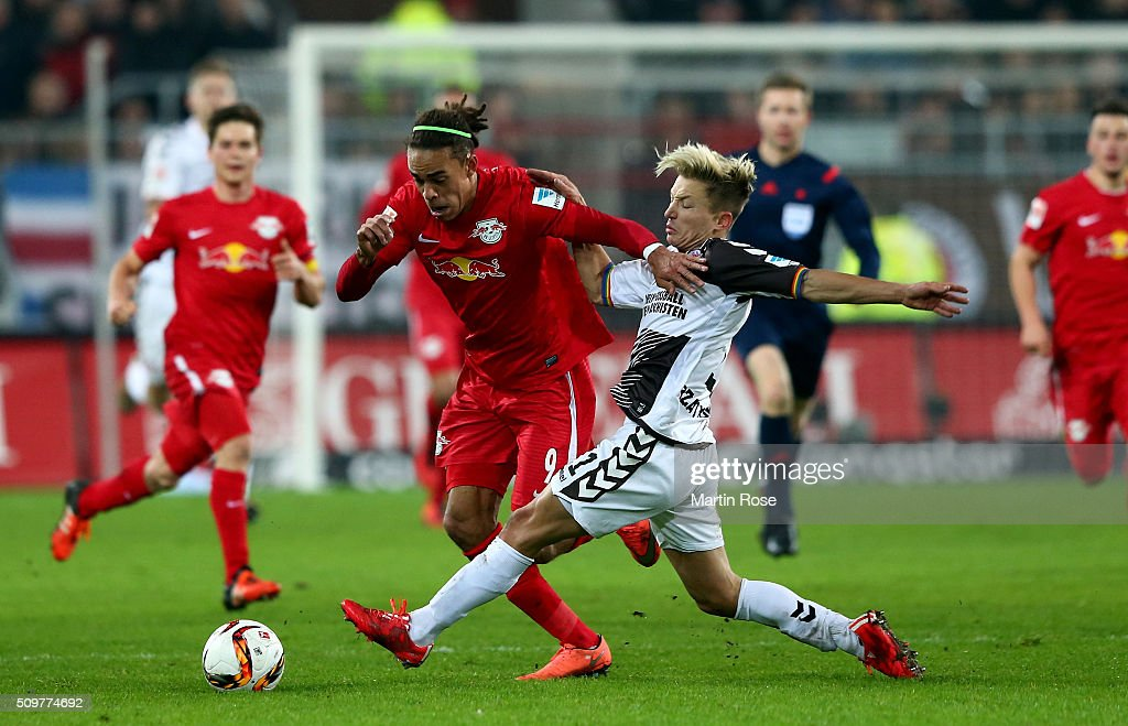 Marc Rzatkowski (R) of St. Pauli challenges for the ball with <a gi-track='captionPersonalityLinkClicked' href=/galleries/search?phrase=Yussuf+Poulsen&family=editorial&specificpeople=7753748 ng-click='$event.stopPropagation()'>Yussuf Poulsen</a> of Leipzig during the second Bundesliga match between FC St. Pauli and RB Leipzig at Millerntor Stadium on February 12, 2016 in Hamburg, Germany.