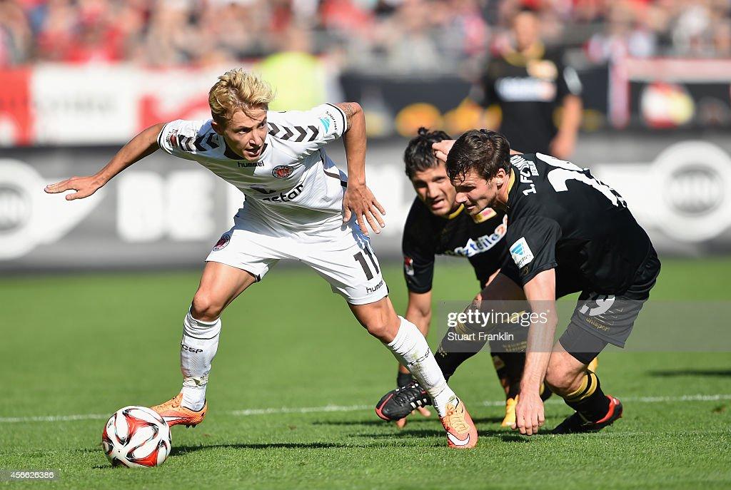 Marc Rzatkowski of St Pauli is challenged by Michael Parensen of Berlin during the Second Bundesliga match between FC St Pauli and 1 FC Union Berlin...