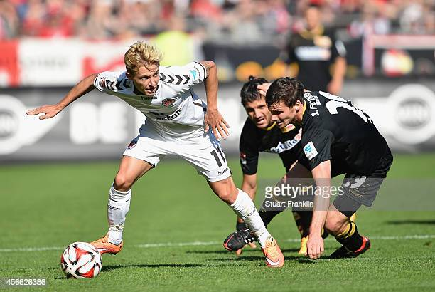 Marc Rzatkowski of St Pauli is challenged by Michael Parensen of Berlin during the Second Bundesliga match between FC St Pauli and 1 FC Union Berlin...