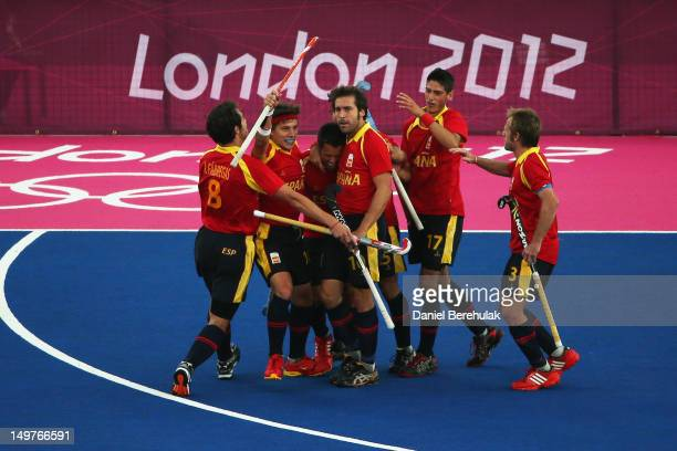Marc Salles of Spain celebrates with team mates after scoring a goal during the Men's Hockey match between South Africa and Spain on Day 7 of the...