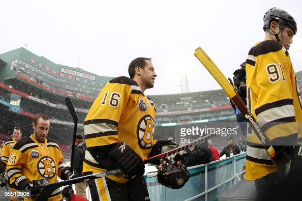 Marc Savard and Marco Sturm of the Boston Bruins walk on the ice during practice for the Bridgestone NHL Winter Classic on December 31 2009 at the...