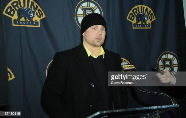 Marc Savard of the Boston Bruins addresses the media with an update of his injury before the game against the New York Rangers at the TD Garden on...