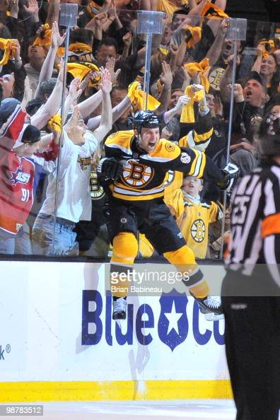 Marc Savard of the Boston Bruins celebrates after scoring a goal in overtime against the Philadelphia Flyers in Game One of the Eastern Conference...