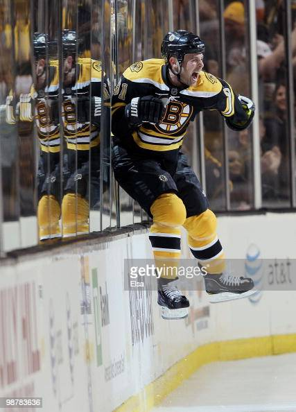 Marc Savard of the Boston Bruins celebrates his game winning goal in the overtime period against the Philadelphia Flyers in Game One of the Eastern...