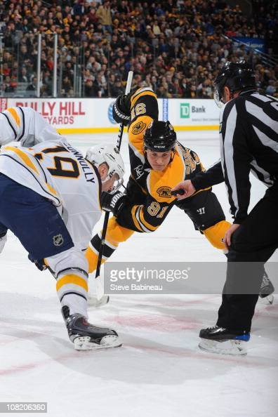 Marc Savard of the Boston Bruins faces off against Tim Connolly of the Buffalo Sabres at the TD Garden on January 20 2011 in Boston Massachusetts