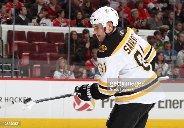 Marc Savard of the Boston Bruins flips a puck on the blade of his stick during a NHL game against the Carolina Hurricanes on January 18 2011 at RBC...