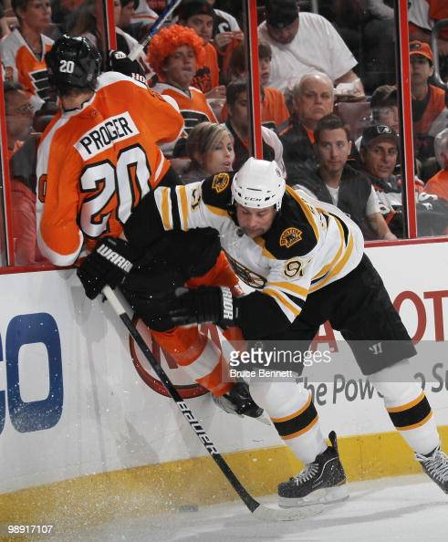 Marc Savard of the Boston Bruins hits Chris Pronger of the Philadelphia Flyers in Game Four of the Eastern Conference Semifinals during the 2010 NHL...