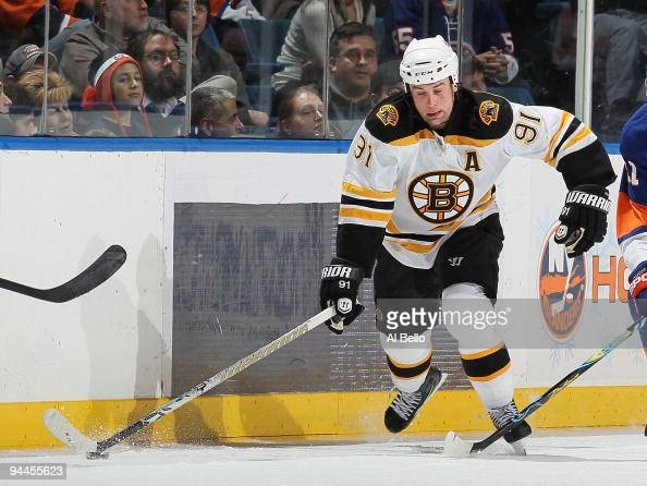 Marc Savard of The Boston Bruins in action against The New York Islanders during their game at the Nassau Coliseum on December 12 2009 at the Nassau...