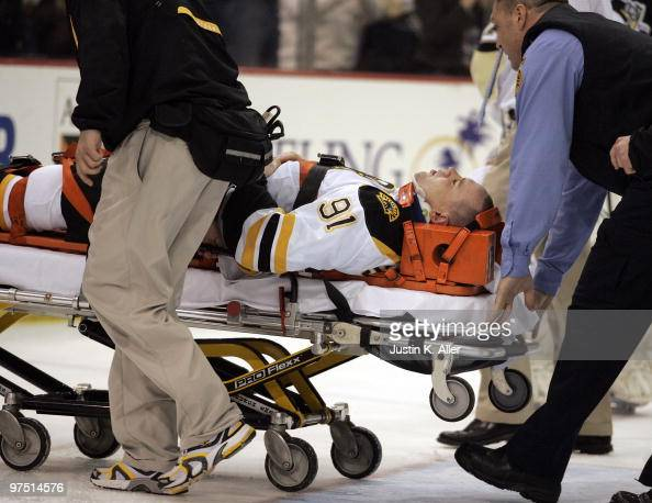 Marc Savard of the Boston Bruins is taken off the ice by medical staff after being injured in the third period against the Pittsburgh Penguins at...