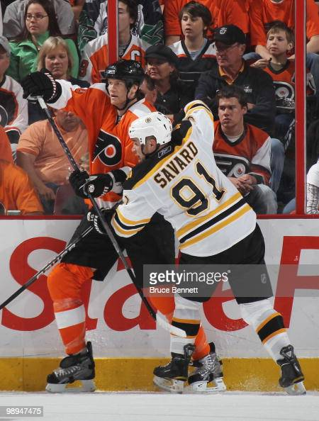 Marc Savard of the Boston Bruins skates against Chris Pronger of the Philadelphia Flyers in Game Four of the Eastern Conference Semifinals during the...