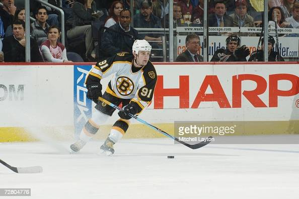 Marc Savard of the Boston Bruins skates with puck during a NHL hockey game against the Washington Capitals at the Verizon Center November 15 2006 in...