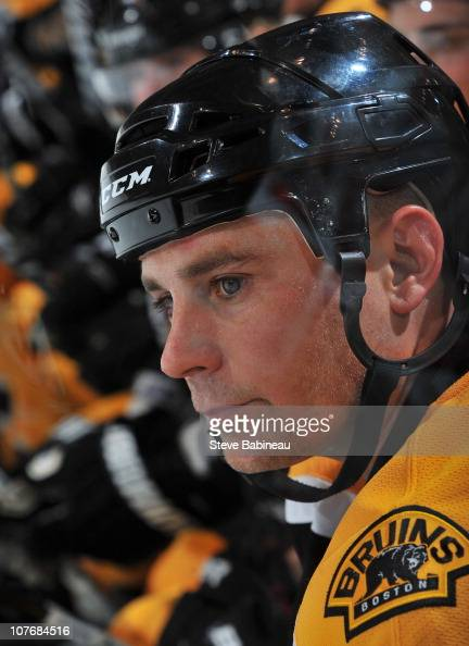 Marc Savard of the Boston Bruins watches the play from the bench against the Washington Capitals at the TD Garden on December 18 2010 in Boston...