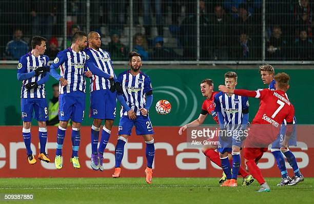 Marc Schnatterer of 1FC Heidenheim shoots from a free kick during the DFB Cup quarter final match between 1 FC Heidenheim and Hertha BSC at...