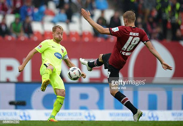 Marc Schnatterer of Heidenheim asnd Hanno Behrens of Nuernberg compete for the ball during the Second Bundesliga match between 1 FC Nuernberg and 1...