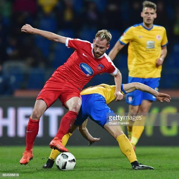 Marc Schnatterer of Heidenheim is challenged by Quirin Moll of Braunschweig during the Second Bundesliga match between Eintracht Braunschweig and 1...