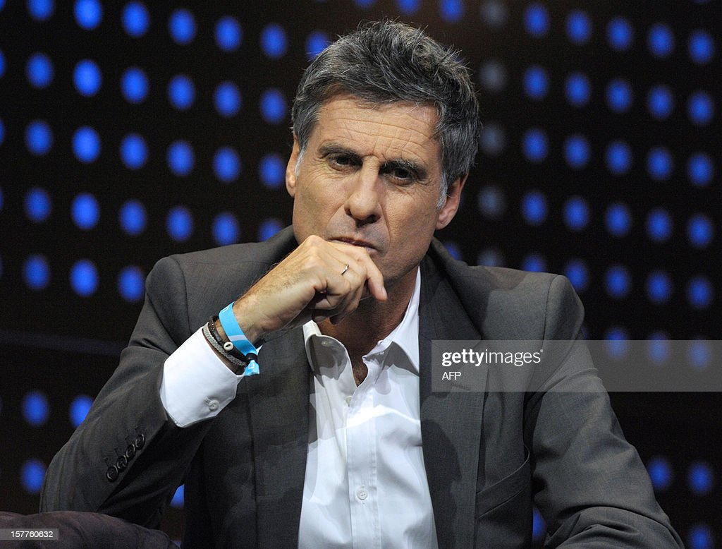 Marc Simoncini, Founder and CEO of Meetic and Jaina Capital listens while taking part in a jury for a Start-Up Competition during LeWeb conference in Saint-Denis, near Paris on December 6, 2012. Le Web is Europe's largest tech conference, bringing together the entrepreneurs, leaders and influencers who shape the future of the internet.
