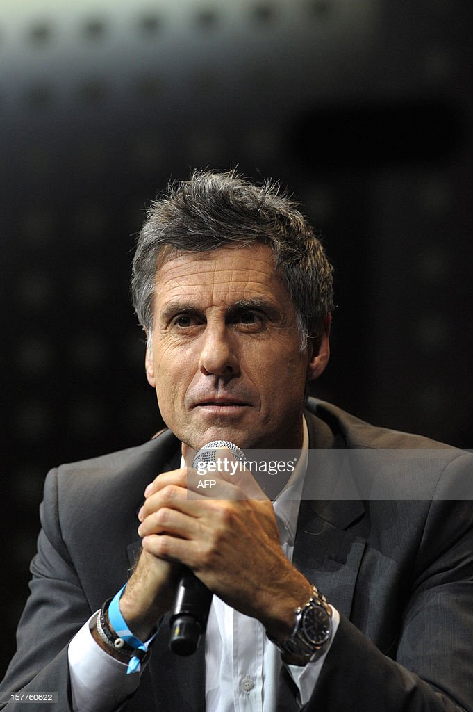 Marc Simoncini, Founder and CEO of Meetic and Jaina Capital talks while taking part in a jury for a Start-Up Competition during LeWeb conference in Saint-Denis, near Paris on December 6, 2012. Le Web is Europe's largest tech conference, bringing together the entrepreneurs, leaders and influencers who shape the future of the internet.