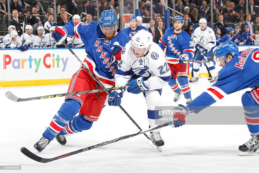Marc Staal and Dylan McIlrath of the New York Rangers defend against Erik Condra of the Tampa Bay Lightning at Madison Square Garden on April 5 2016...
