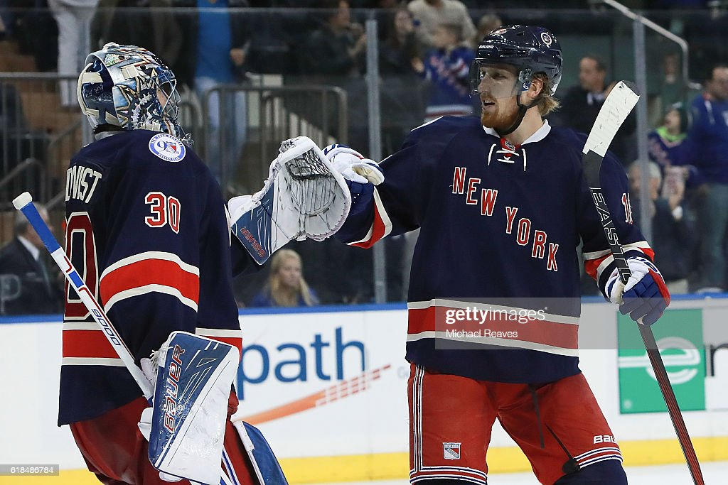 Marc Staal #18 and Henrik Lundqvist #30 of the New York Rangers celebrate after they defeated the Boston Bruins 5-2 at Madison Square Garden on October 26, 2016 in New York City.
