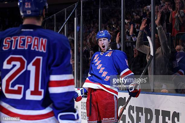 Marc Staal celebrates with Derek Stepan of the New York Rangers after Stepan assisted Staal on his second period goal against the Ottawa Senators in...