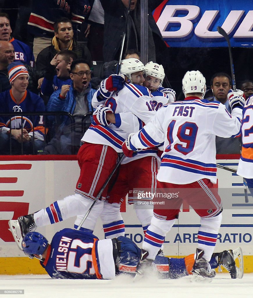 Marc Staal #18, Chris Kreider #20 and Jesper Fast #19 of the New York Rangers celebrate Kreider's goal at 19:14 of the second period against the New York Islanders at the Barclays Center on January 14, 2016 in the Brooklyn borough of New York City.