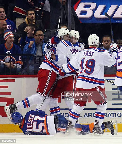 Marc Staal Chris Kreider and Jesper Fast of the New York Rangers celebrate Kreider's goal at 1914 of the second period against the New York Islanders...