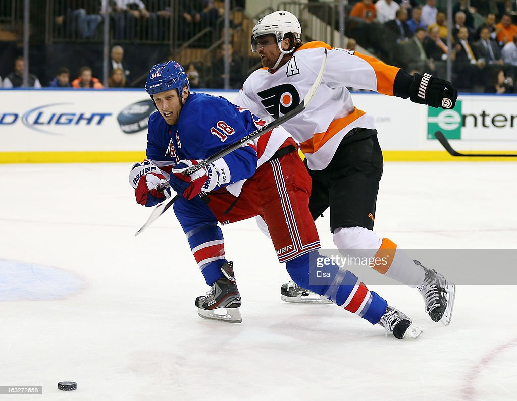 <a gi-track='captionPersonalityLinkClicked' href=/galleries/search?phrase=Marc+Staal&family=editorial&specificpeople=3809026 ng-click='$event.stopPropagation()'>Marc Staal</a> #18 of the New York Rangers and Scott Hartnell #19 of the Philadelphia Flyers on March 5, 2013 at Madison Square Garden in New York City.