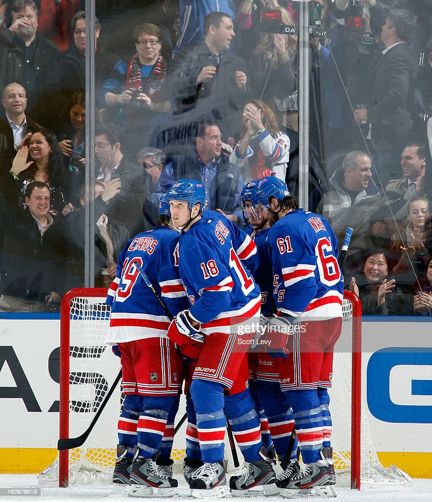 <a gi-track='captionPersonalityLinkClicked' href=/galleries/search?phrase=Marc+Staal&family=editorial&specificpeople=3809026 ng-click='$event.stopPropagation()'>Marc Staal</a> #18 of the New York Rangers celebrates his second period goal against the Tampa Bay Lightning at Madison Square Garden on February 28, 2013 in New York City.