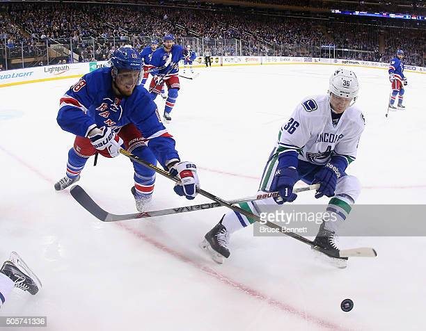 Marc Staal of the New York Rangers checks Jannik Hansen of the Vancouver Canucks during the third period at Madison Square Garden on January 19 2016...