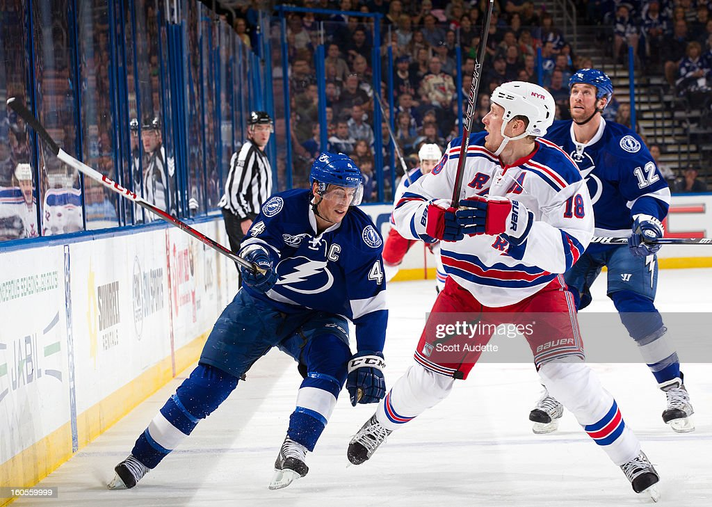 <a gi-track='captionPersonalityLinkClicked' href=/galleries/search?phrase=Marc+Staal&family=editorial&specificpeople=3809026 ng-click='$event.stopPropagation()'>Marc Staal</a> #18 of the New York Rangers checks <a gi-track='captionPersonalityLinkClicked' href=/galleries/search?phrase=Vincent+Lecavalier&family=editorial&specificpeople=201915 ng-click='$event.stopPropagation()'>Vincent Lecavalier</a> #4 of the Tampa Bay Lightning during the first period of their game at the Tampa Bay Times Forum on February 2, 2013 in Tampa, Florida.