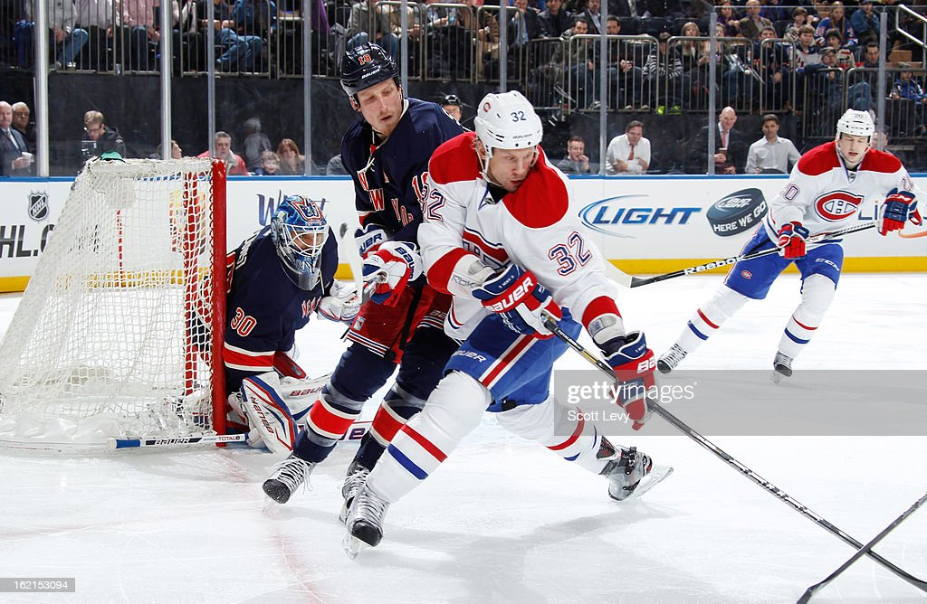 <a gi-track='captionPersonalityLinkClicked' href=/galleries/search?phrase=Marc+Staal&family=editorial&specificpeople=3809026 ng-click='$event.stopPropagation()'>Marc Staal</a> #18 of the New York Rangers defends against <a gi-track='captionPersonalityLinkClicked' href=/galleries/search?phrase=Travis+Moen&family=editorial&specificpeople=208110 ng-click='$event.stopPropagation()'>Travis Moen</a> #32 of the Montreal Canadiens at Madison Square Garden on February 19, 2013 in New York City.