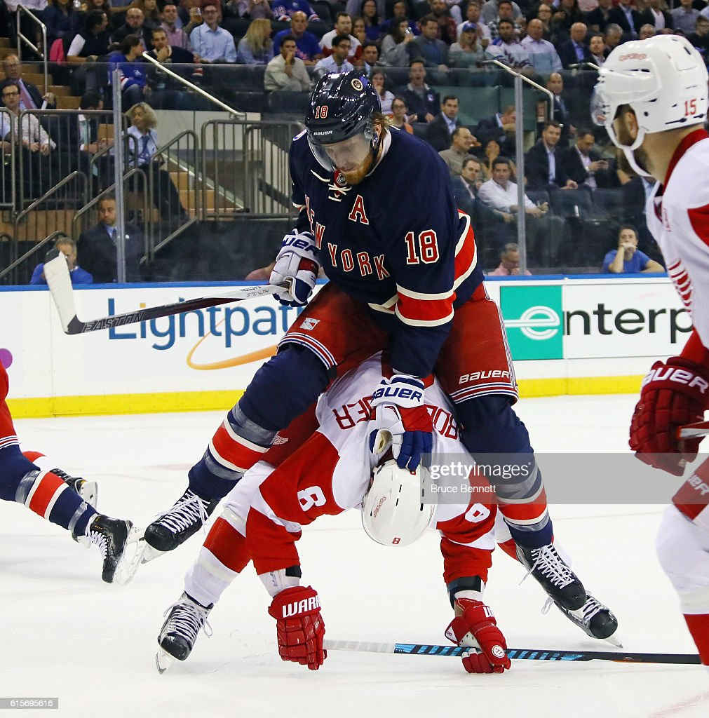 Marc Staal #18 of the New York Rangers holds down Justin Abdelkader #8 of the Detroit Red Wings during the first period at Madison Square Garden on October 19, 2016 in New York City.