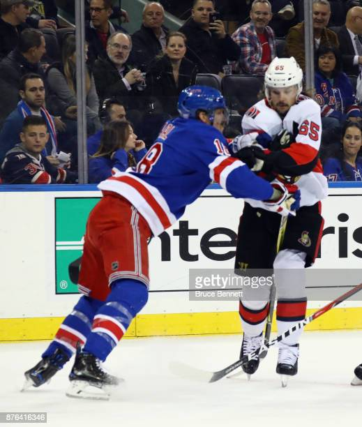 Marc Staal of the New York Rangers holds up Erik Karlsson of the Ottawa Senators during the first period at Madison Square Garden on November 19 2017...