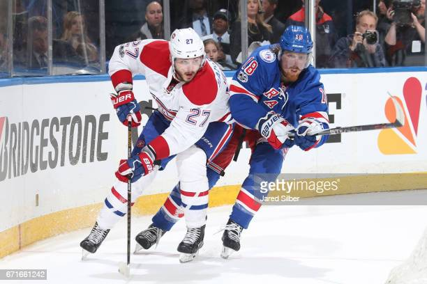 Marc Staal of the New York Rangers skates against Alex Galchenyuk of the Montreal Canadiens in Game Six of the Eastern Conference First Round during...