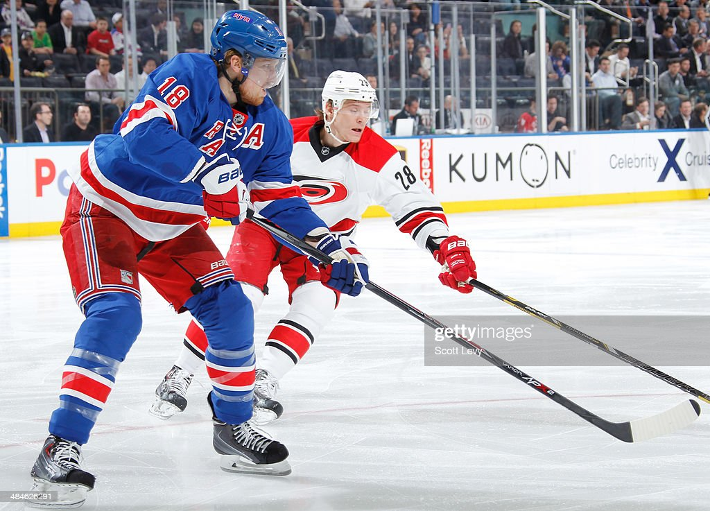 <a gi-track='captionPersonalityLinkClicked' href=/galleries/search?phrase=Marc+Staal&family=editorial&specificpeople=3809026 ng-click='$event.stopPropagation()'>Marc Staal</a> #18 of the New York Rangers skates against <a gi-track='captionPersonalityLinkClicked' href=/galleries/search?phrase=Alexander+Semin&family=editorial&specificpeople=206654 ng-click='$event.stopPropagation()'>Alexander Semin</a> #28 of the Carolina Hurricanes at Madison Square Garden on April 08, 2014 in New York City. The New York Rangers won 4-1.