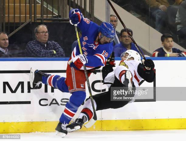 Marc Staal of the New York Rangers steps into JeanGabriel Pageau of the Ottawa Senators during the third period at Madison Square Garden on November...