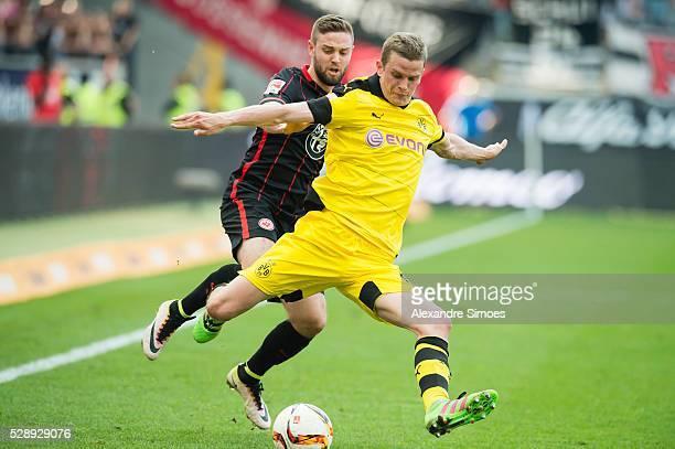 Marc Stendera of Eintracht Frankfurt challenges Sven Bender of Borussia Dortmund during the Bundesliga match between Eintracht Frankfurt v Borussia...